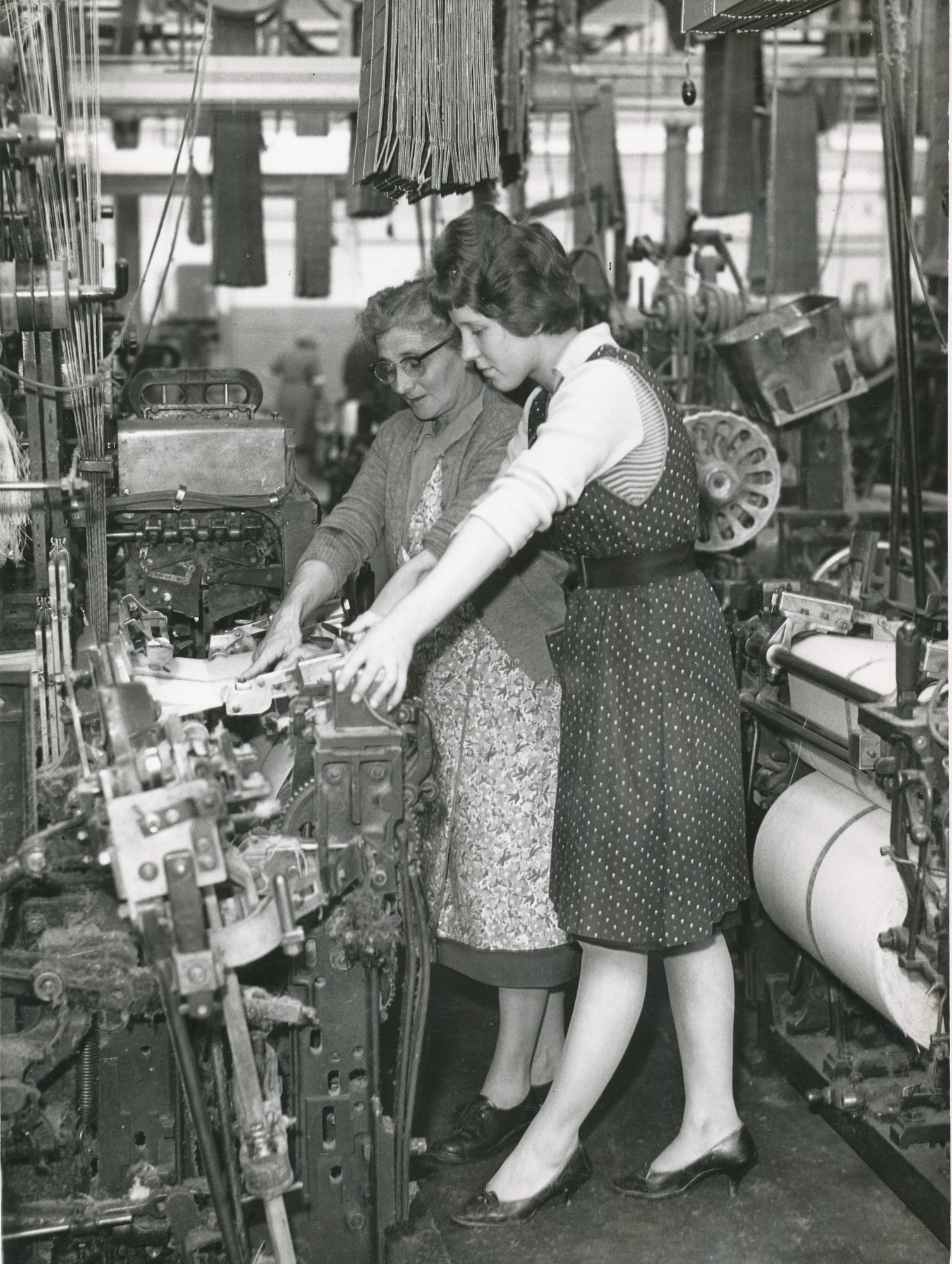 Two women weavers at loom image