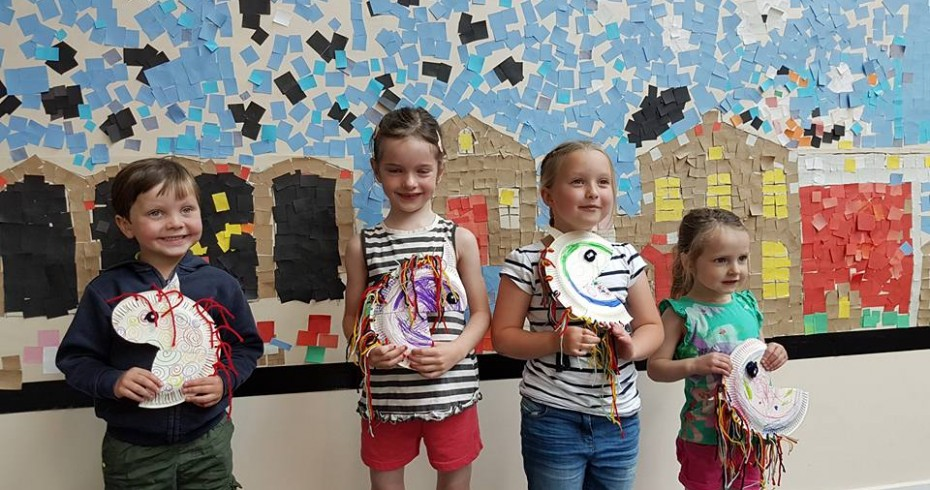 children showing their crafts from event