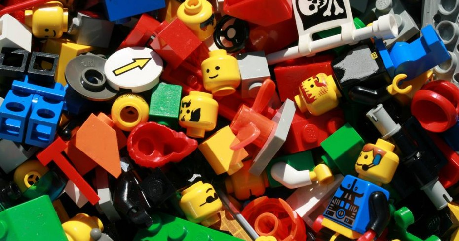 image depicting pieces of lego, including figures, bricks and other miscellaneous pices