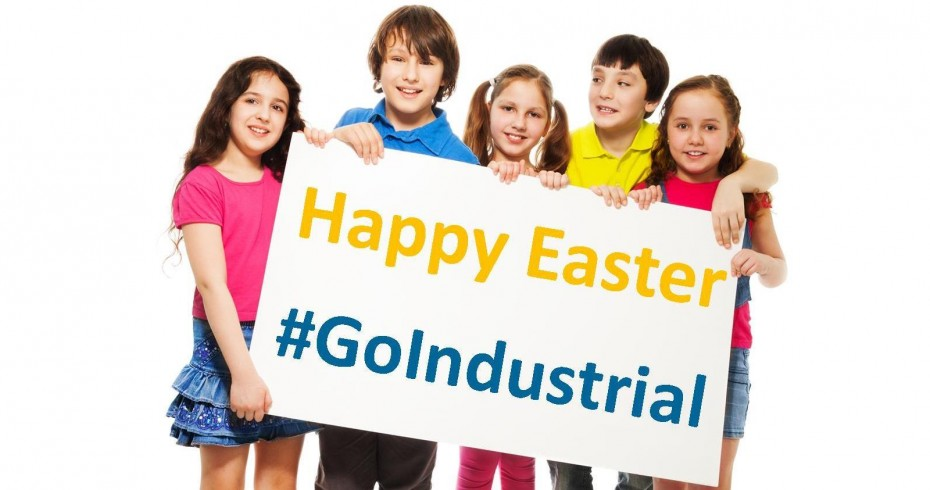 group of children holding up a sign that says happy easter go industrial
