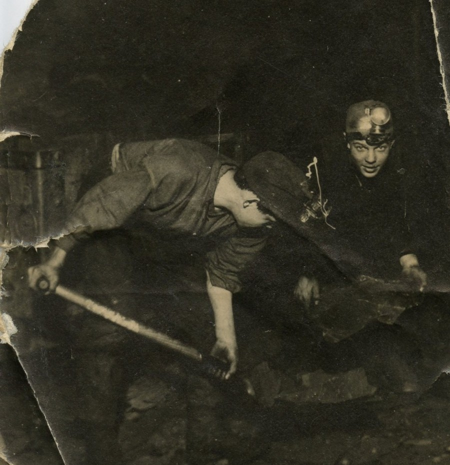 black and white photograph of 2 miners in shale pit