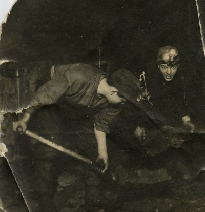 2 young miners loading shale underground in Westwood pit image