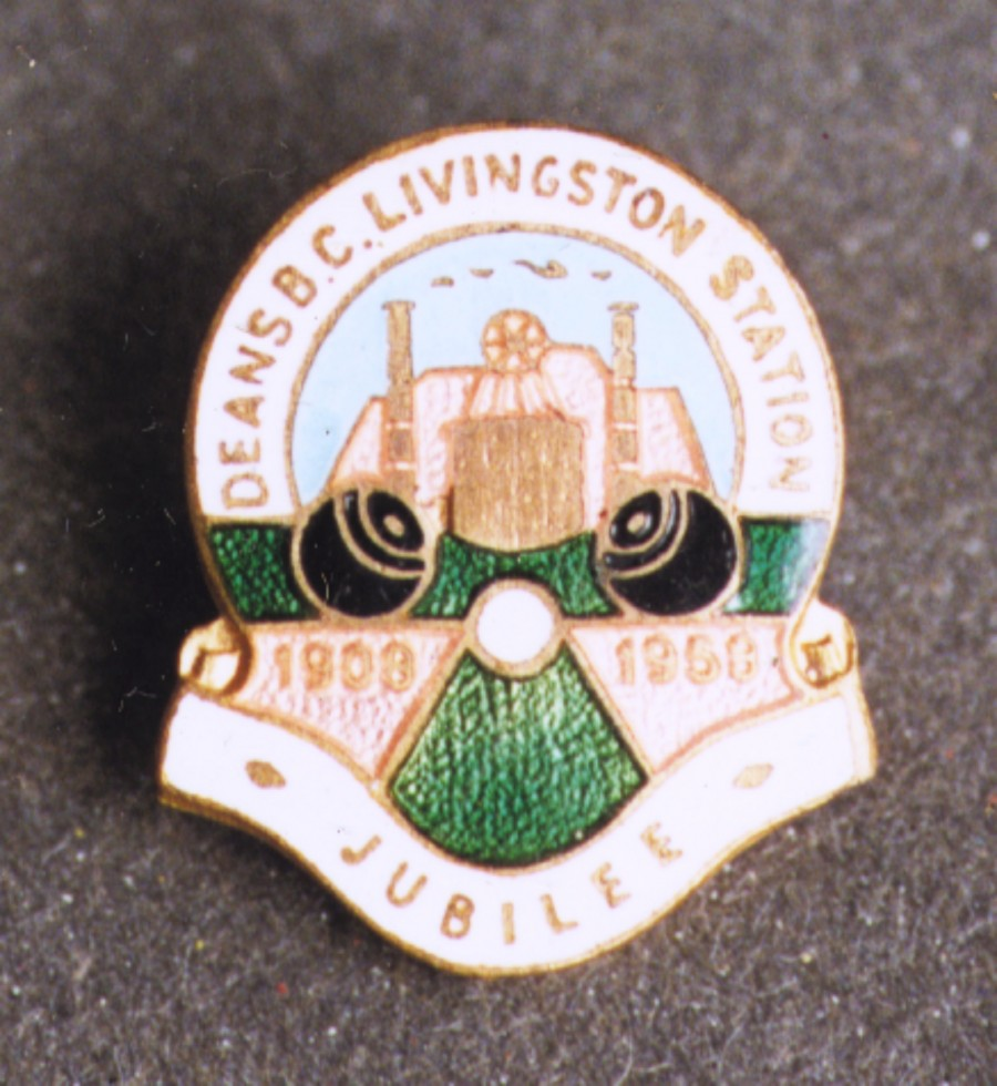badge commemorating 50th jubilee of deans B.C. livingston station. depicted is mine in background and two bowling balls in foreground