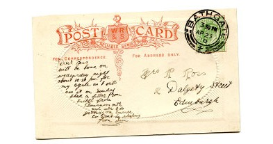 old postcard, reverse, with writing on lefthandside and address on right