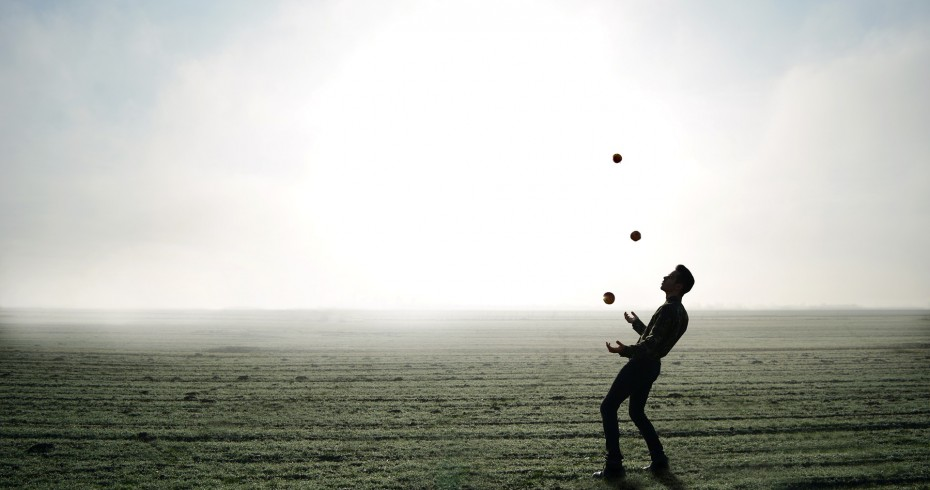image of a juggler in a field