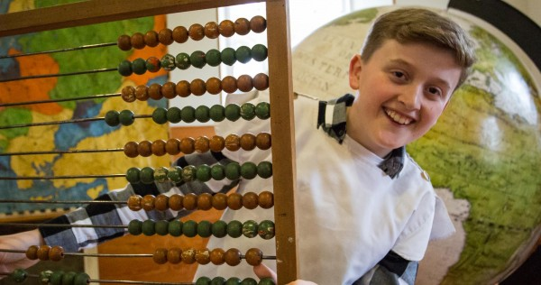 child holding abacus 2