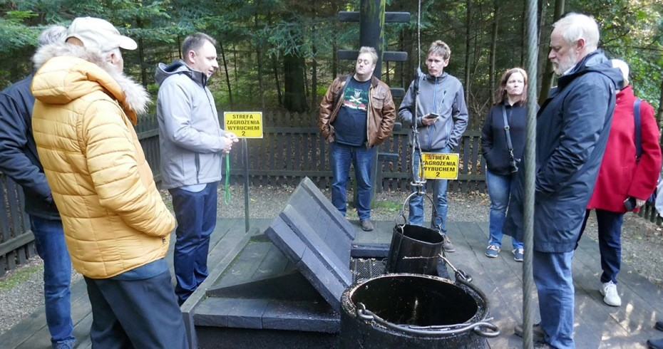 visitors at a shale oil mine in poland
