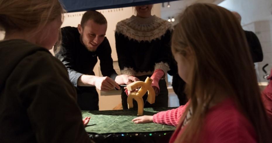 chuildren watching a puppet show