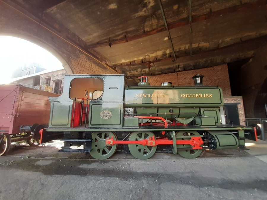 green locomotive engine with newbattle collieries written on the side