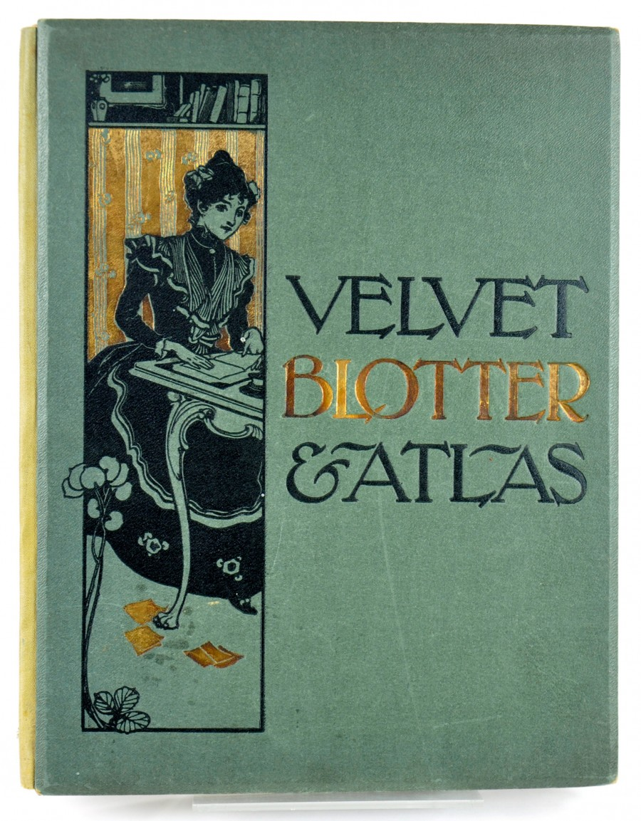 front page, velvet blotter and atlas, green front cover with image of lady sitting at a table