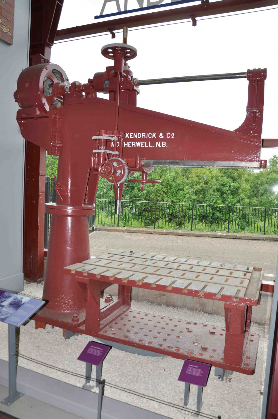 radial drill. painted red, with writing: kendrick & co / motherwell n.b.
