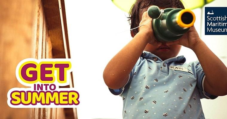 child with binocular